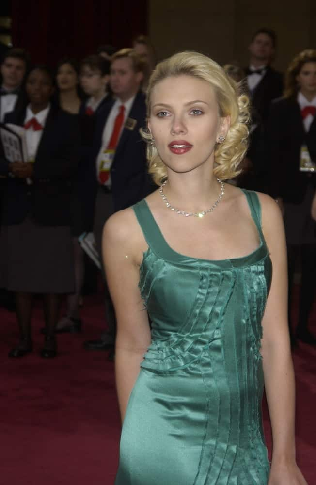 Scarlett Johansson's classy green dress was a nice complement to her brushed back shoulder-length hair with curls at the tips at the 76th Annual Academy Awards in Hollywood on February 29, 2004.