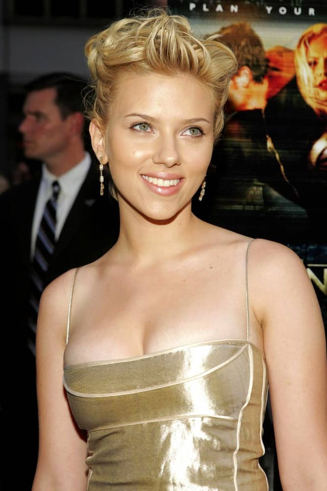Scarlett Johansson paired her lovely Cartier earrings with an elegant and unique upstyle hair and a sexy dress at THE ISLAND Premiere, The Ziegfeld Theater in New York, NY on July 11, 2005.