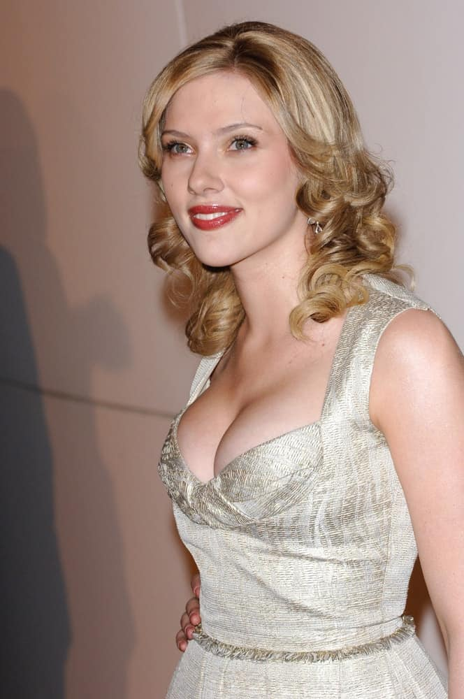 Actress Scarlett Johansson wowed everyone with her lovely silver dress and loose shoulder-length curls with layers at the Los Angeles premiere of her new movie Match Point on December 8, 2005 in Los Angeles, CA.
