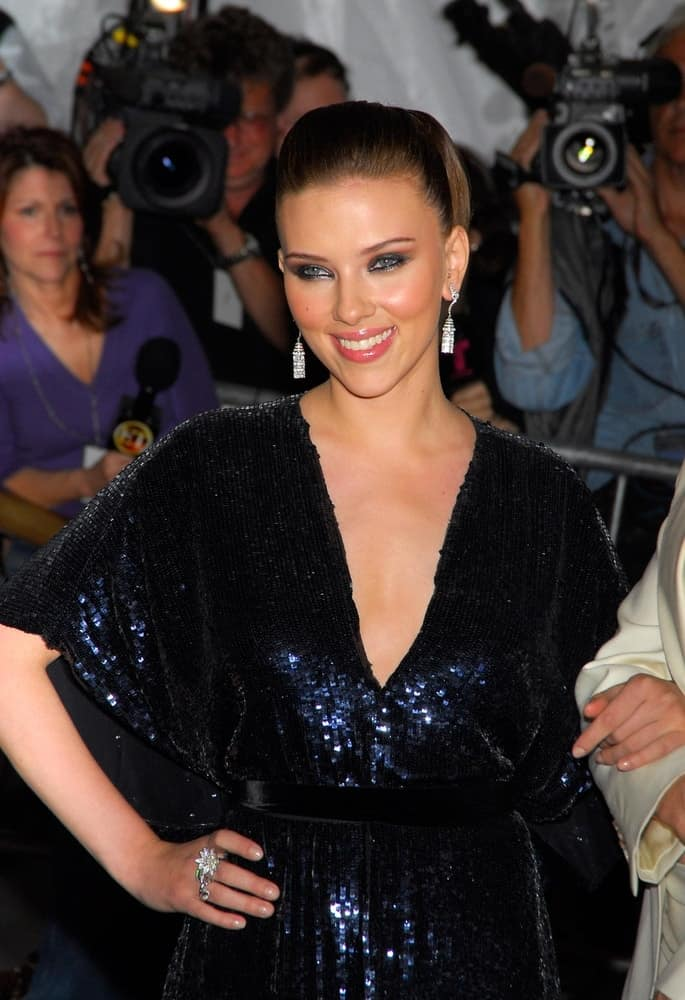 Scarlett Johansson wore a Stella McCartney dress at the AngloMania Tradition and Transgression in British Fashion Opening Gala held at The Metropolitan Museum of Art in New York on May 01, 2006. She paired this with a lovely and neat slick bun hairstyle.