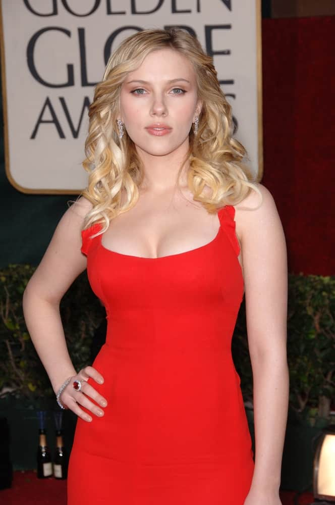 Scarlett Johansson stole the spotlight with her stunning red dress and loose blond tousled waves resting on her shoulders at the 63rd Annual Golden Globe Awards at the Beverly Hilton Hotel on January 16, 2006.