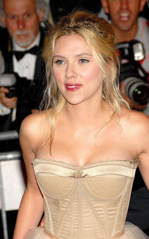 Scarlett Johansson wore a Dolce & Gabbana nude dress at the Annual Opening Night Gala of Superheroes Fashion and Fantasy, Metropolitan Museum of Art Costume Institute in New York on May 05, 2008. She paired this with a messy half-up hairstyle with loose tendrils and a headband.