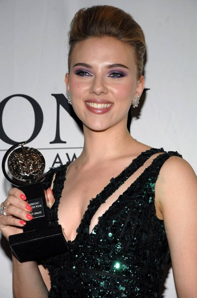 Scarlett Johansson won at the 64th Annual Antoinette Perry Tony Awards held at the LA Sports Club on the Plaza-Rockefeller Center in New York on June 13, 2010. She wore a black sequined dress that she paired with a bun hairstyle that has a pompadour look.