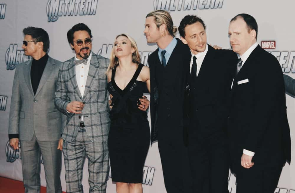 On April 17, 2012, Scarlett Johansson and Robert Downey Jr. were at The Avengers Premiere photocall at the rooftop of The Ritz-Carlton hotel. Johansson wore a smart casual outfit with her classy blond ponytail with highlights.