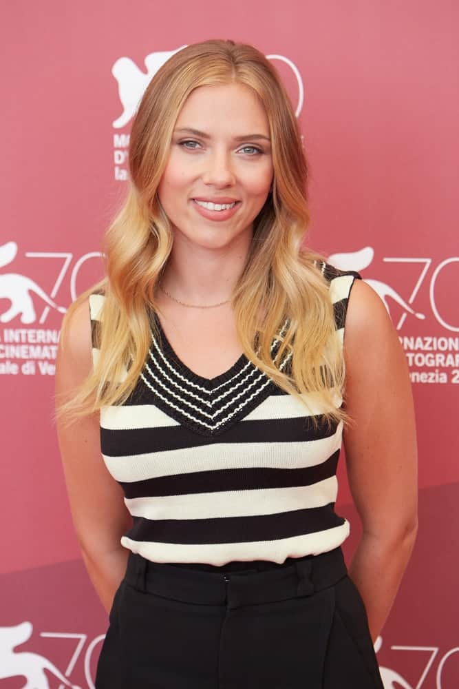Scarlett Johansson kept it simple and lovely with her casual striped blouse that she paired with her long and layered wavy hairstyle that has a sandy blond tone at the ' Under the skin ' premiere during the 70th Venice Film Festival on September 3, 2013 in Venice.