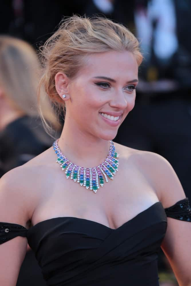 Scarlett Johansson wore a breathtaking black off-shoulder dress that went quite well with her tousled and messy bun hairstyle with loose tendrils at the 'Under The Skin' Premiere during the 70th Venice Film Festival on September 03, 2013 in Venice, Italy.