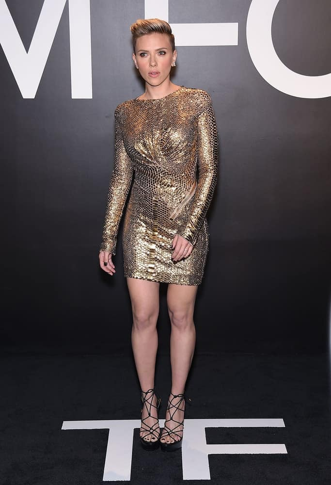 Scarlett Johansson wore a gorgeous golden short dress to complement her brushed-up side-swept pixie hairstyle that has a slight pompadour look at the Tom Ford Autumn/Winter 2015 Womenswear Collection Presentation on February 20, 2015 in Hollywood, CA.