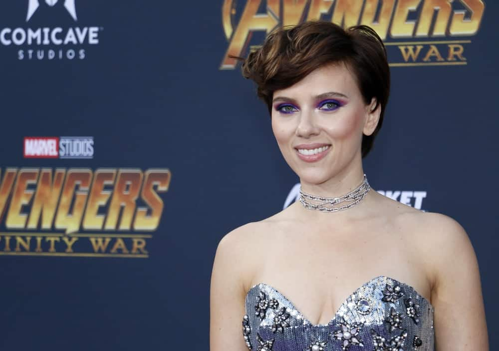 Scarlett Johansson paired colorful eye shadow with her strapless silver sequined dress and side-swept short hairstyle with waves at the premiere of Disney and Marvel's 'Avengers: Infinity War' held at the El Capitan Theatre in Hollywood, USA on April 23, 2018.