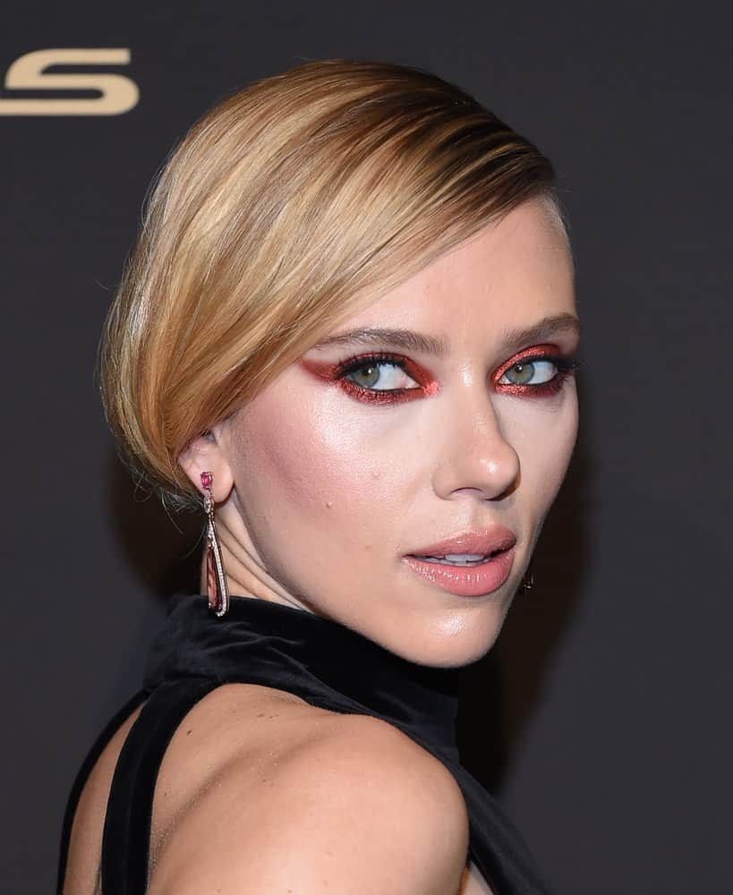 Scarlett Johansson attended the ELLE Women in Hollywood on October 14, 2019 in Westwood, CA. She stunned everyone with her black dress, smoky eyes and elegant low bun hairstyle with long side-swept bangs.