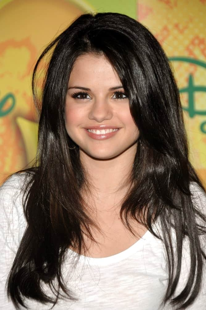 Selena Gomez attended the press conference for New York Times Talks with WIZARDS OF WAVERLY PLACE at The Times Center in New York on September 06, 2008. She wore a simple white shirt with her long and layered raven hairstyle.