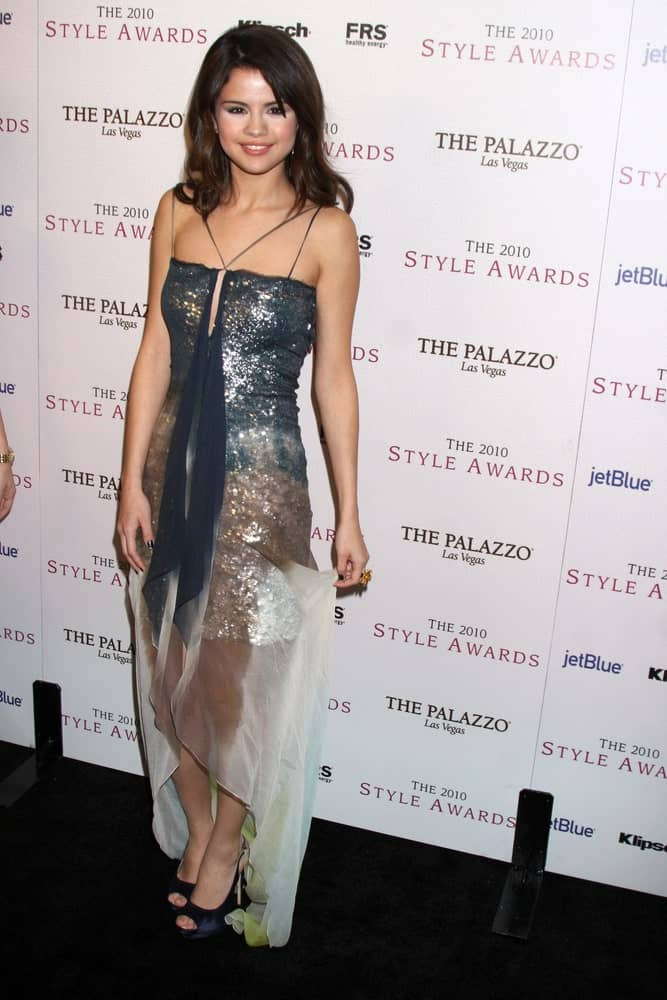 Selena Gomez wore a glittery sequined dress with her shoulder-length layered straight hair when she arrived at the 2010 Hollywood Style Awards at Billy Wilder Theater at the Hammer Museum on December 12, 2010 in Westwood, CA.