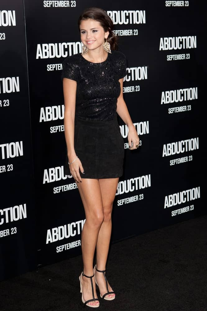 Actress Selena Gomez wore a simple yet sexy black outfit that she paired with a messy low ponytail at the world premiere of 'Abduction' at Grauman's Chinese Theater on Sept 15 2011 in Hollywood.