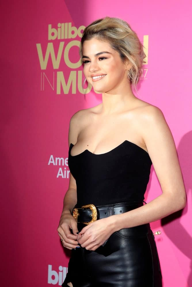 Selena Gomez attended the 2017 Billboard Women in Music at the Ray Dolby Ballroom on November 30, 2017 in Los Angeles, CA. Her sexy black outfit was a nice complement to her messy upstyle that has blond highlights.