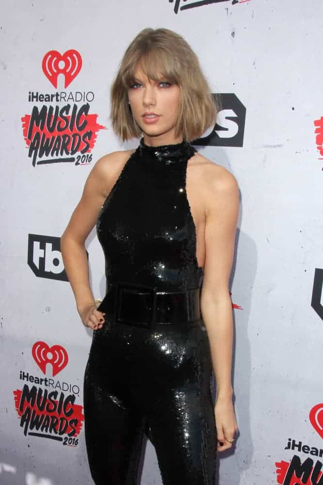 Taylor Swift attended the iHeartRadio Music Awards 2016 held at The Forum on April 3, 2016. She wore a tousled bob cut with full-bangs making her look very chic and sexy along with her black sequined jumpsuit.