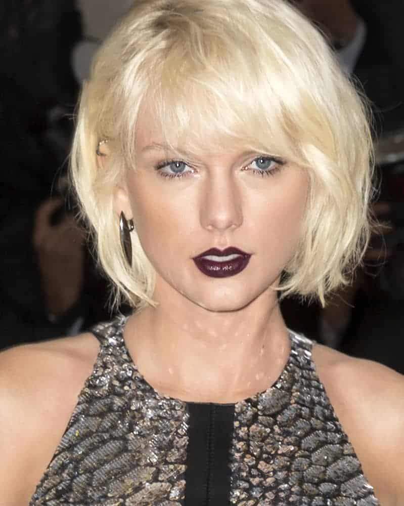 Taylor Swift rocked a frizzy bob cut hairstyle that's perfect for her futuristic themed outfit. This look was worn at the Metropolitan Museum of Art Costume Institute Gala on May 2, 2016.