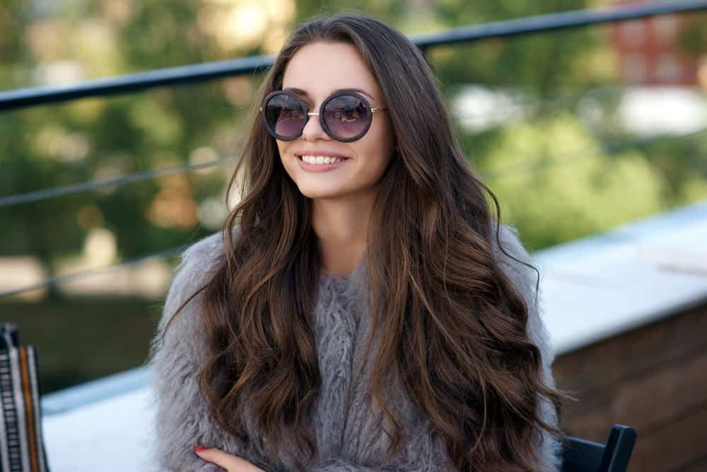 Young woman with long wavy brunette hair