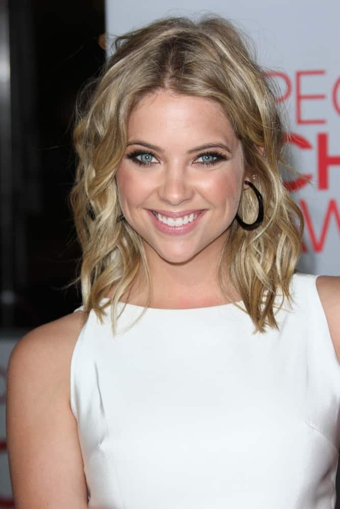 Ashley Benson at the 2012 People's Choice Awards, Nokia Theatre. Los Angeles, CA on January 11, 2012. She was lovely in her white dress and shoulder-length sandy blonde hairstyle with waves and a slight tousle.