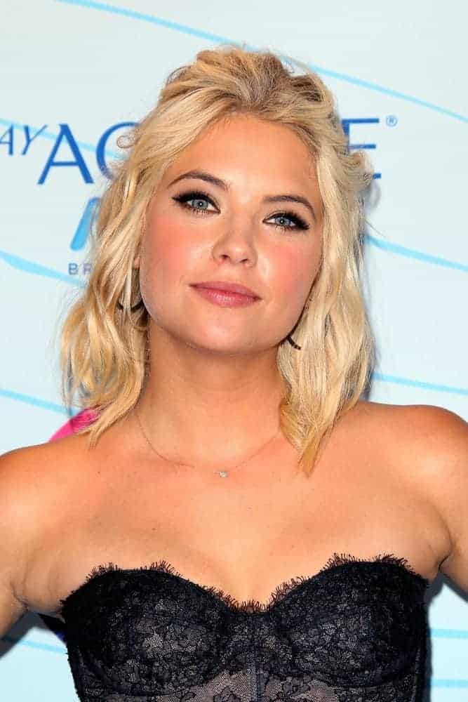 Ashley Benson was at the Press Room of the 2012 Teen Choice Awards at Gibson Amphitheater on July 22, 2012, in Los Angeles, CA. She was stunning in her strapless black corset top and a shoulder-length blonde half-up hairstyle with waves and a tousled finish.