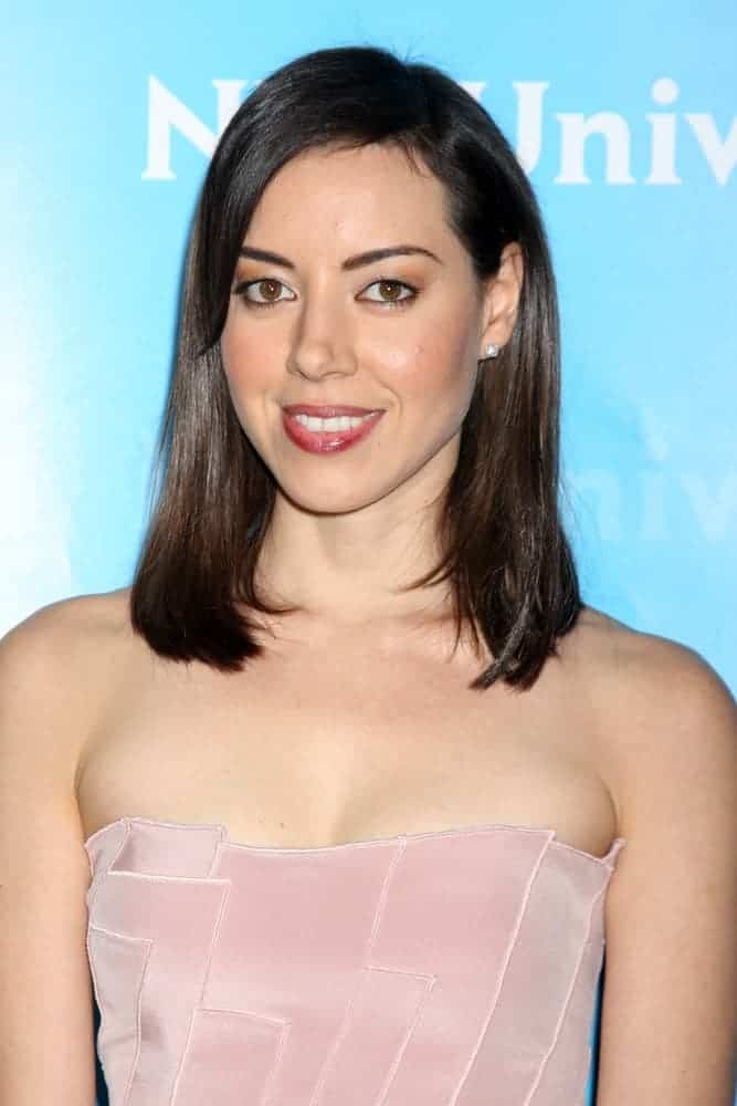 Aubrey Plaza was at the NBC Universal All-Star Winter TCA Party at The Athenaeum on January 6, 2012, in Pasadena, CA. She wore a pink strapless dress that she paired with her shoulder-length raven layered straight hairstyle.