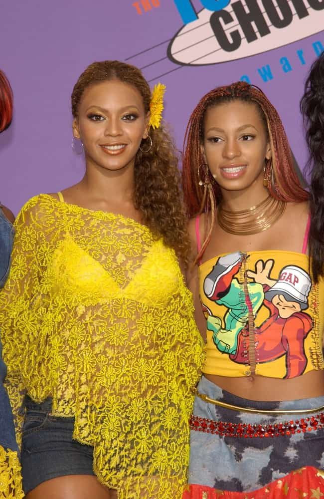 Beyonce gathered her long curly hair into a side ponytail with a sunflower that matches her yellow outfit during the 2001 Teen Choice Awards at the Universal Amphitheatre, Hollywood on August 12, 2001.