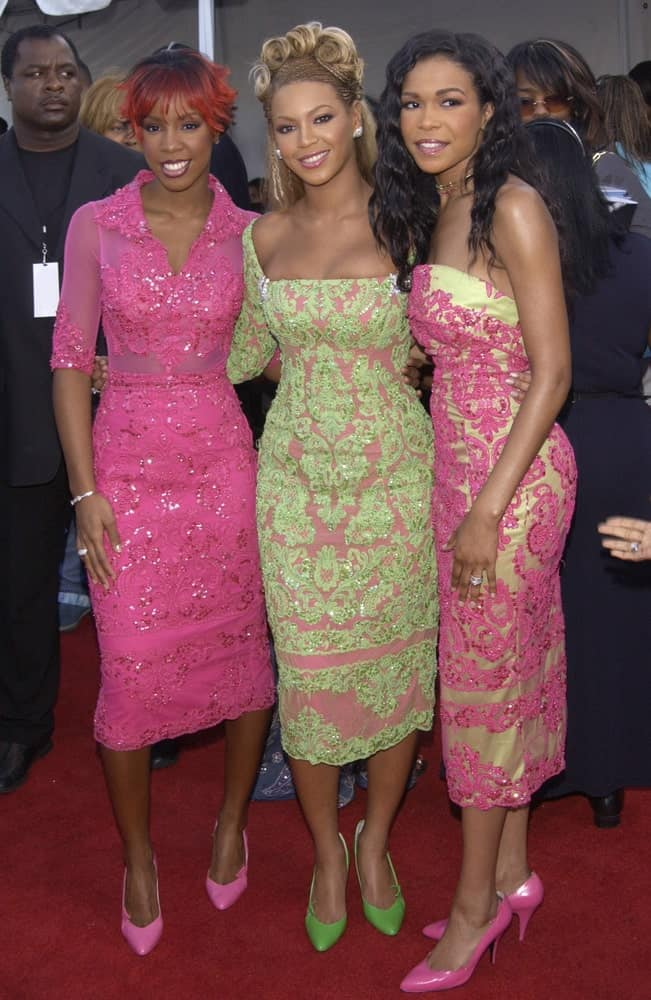 Destiny's Child attended the 7th Annual Soul Train Lady of Soul Awards in Santa Monica, California last August 28, 2001. Beyonce incorporates her slicked half updo with stylish twisted top knots that went perfectly with her lacy green dress.