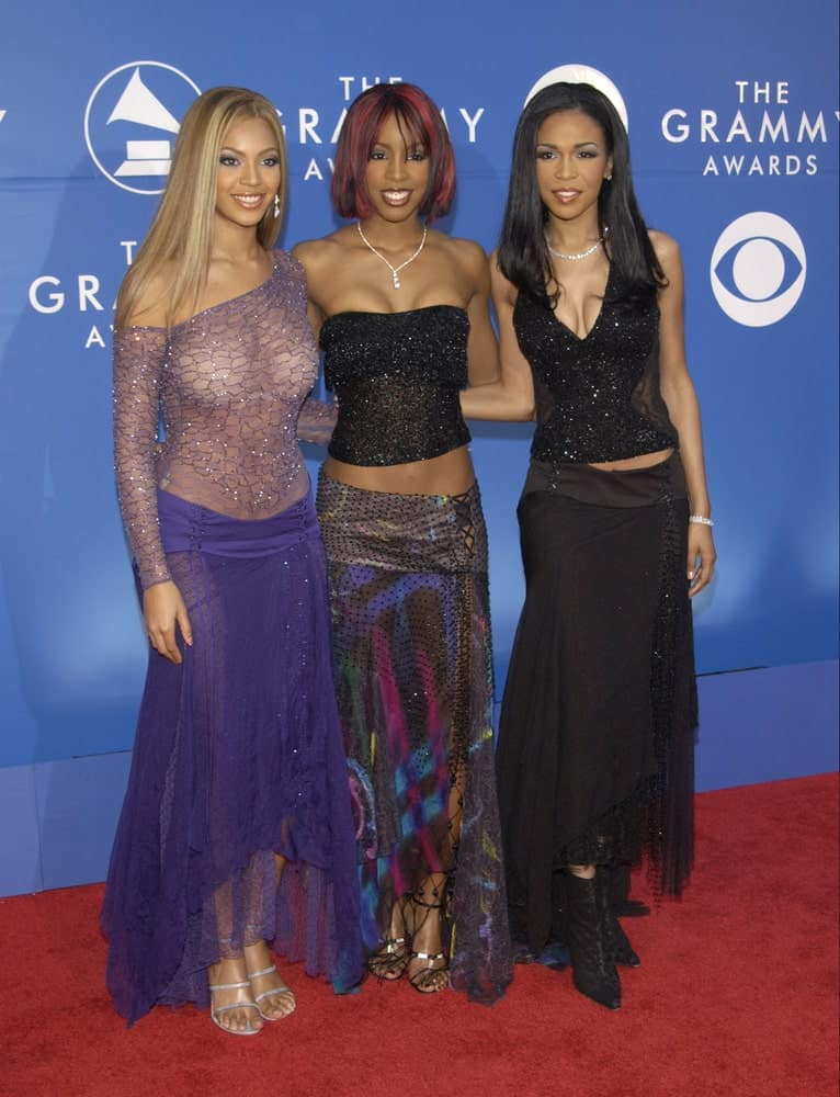 R&B group Destiny's Child arrived for the 2002 Grammy Awards in Los Angeles on February 27, 2002. Beyonce Knowles wore a sheer purple dress along with her light blonde straight hair with a middle parting.