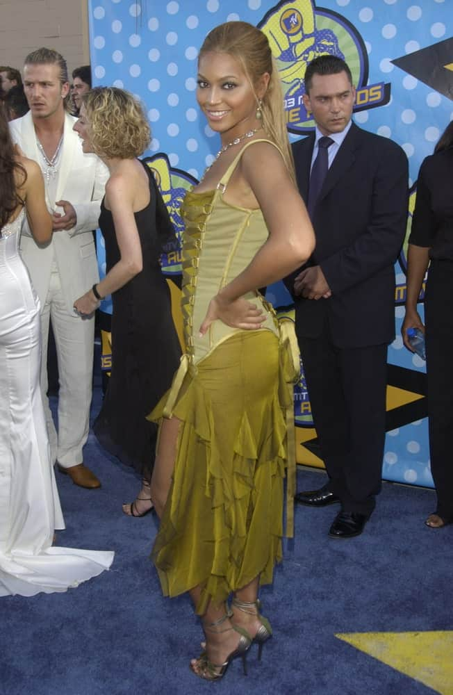 Beyonce Knowles slicked back her hair into a high ponytail with side tendrils at the 2003 MTV Movie Awards in Los Angeles held on May 31, 2003.