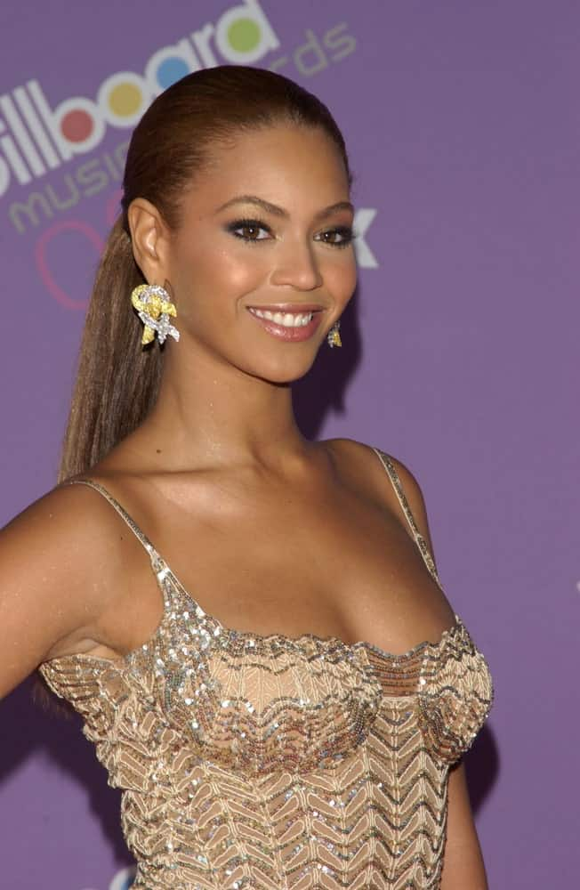 Beyonce Knowles pulled off a slicked ponytail during the 2003 Billboard Music Awards at the MGM Grand, Las Vegas held on December 10, 2003. Gorgeous earrings and a beige sequined dress completed the look.