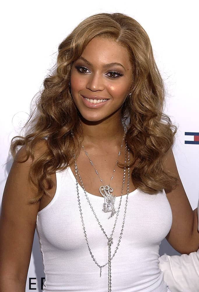 Beyonce Knowles in a casual white top tank paired with her side-parted curls at the launch of her new fragrance A TRUE STAR at the Chelsea Art Museum, NY held on June 24, 2004.