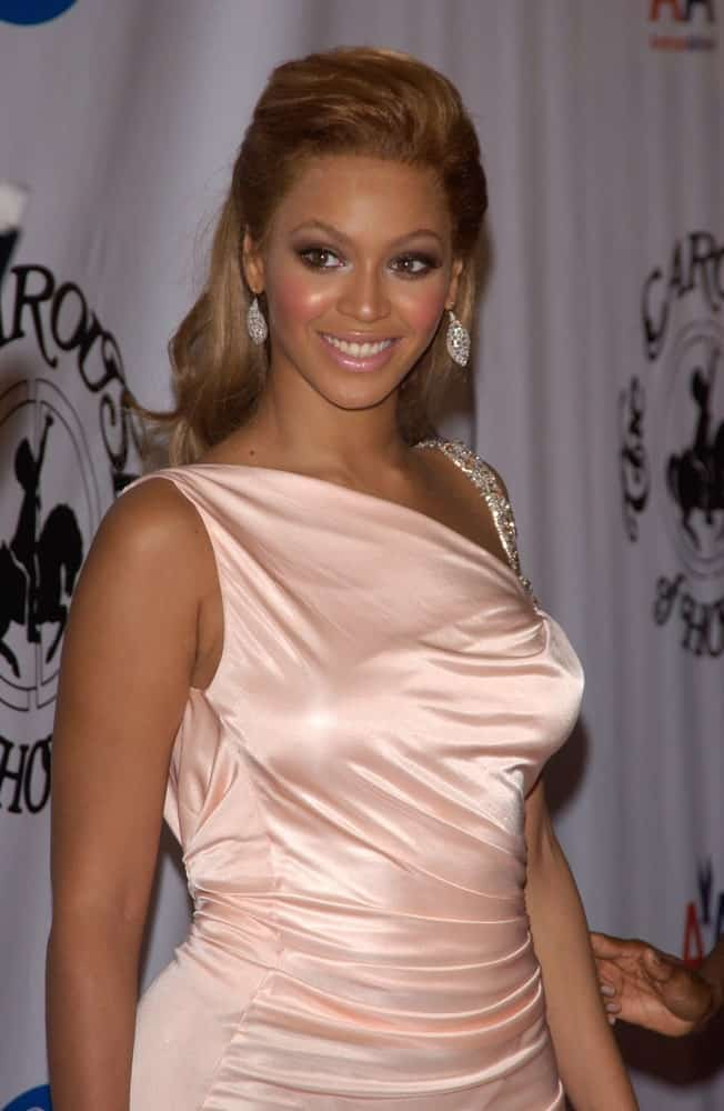 Beyonce Knowles exhibited a charming aura in a blush pink dress paired with a slicked half updo during the 16th Carousel of Hope Ball at the Beverly Hills Hilton held on October 23, 2004.