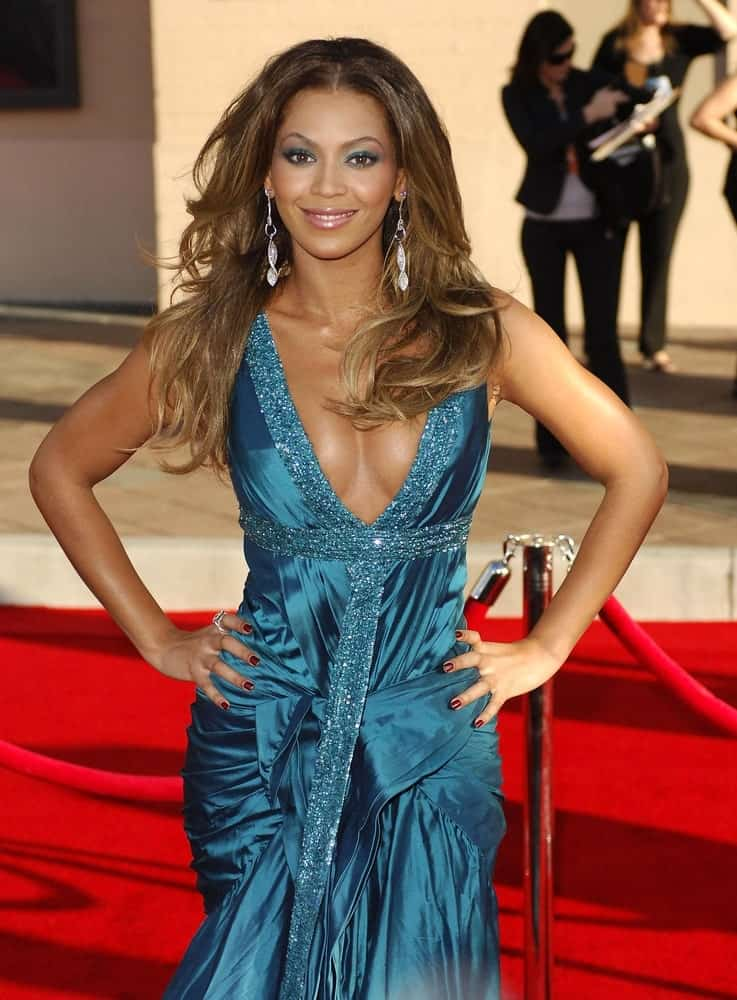 Beyonce rocked a layered wavy hairstyle during the 2006 American Music Awards held at The Shrine Auditorium, Los Angeles, CA on November 21, 2006.