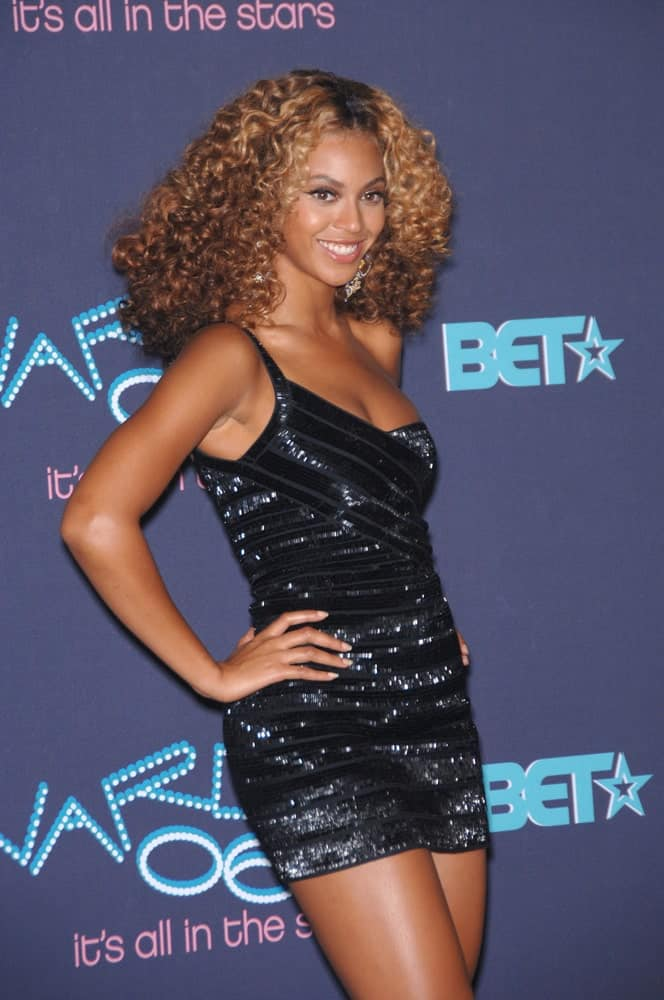 Beyonce Knowles with her coily hair that perfectly goes with a black Herve Leger dress at the BET 2006 Awards Show held on June 27, 2006 at The Shrine Auditorium, Los Angeles, CA.