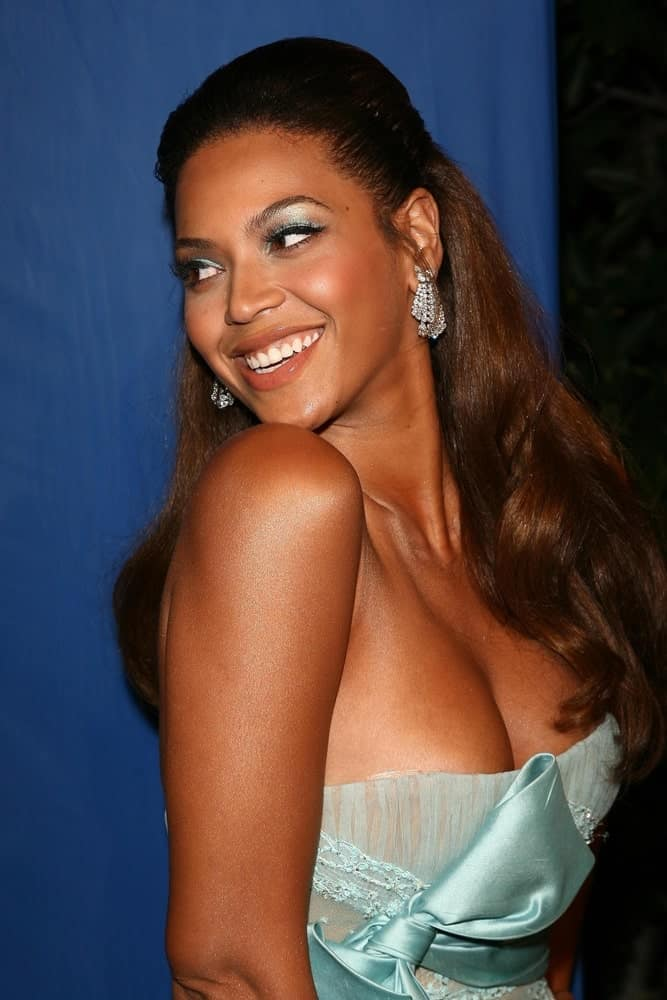 Beyonce with her brunette partial waves arranged into a half updo during the DREAMGIRLS Los Angeles Premiere at the Wilshire Theatre, Los Angeles, CA on December 11, 2006.