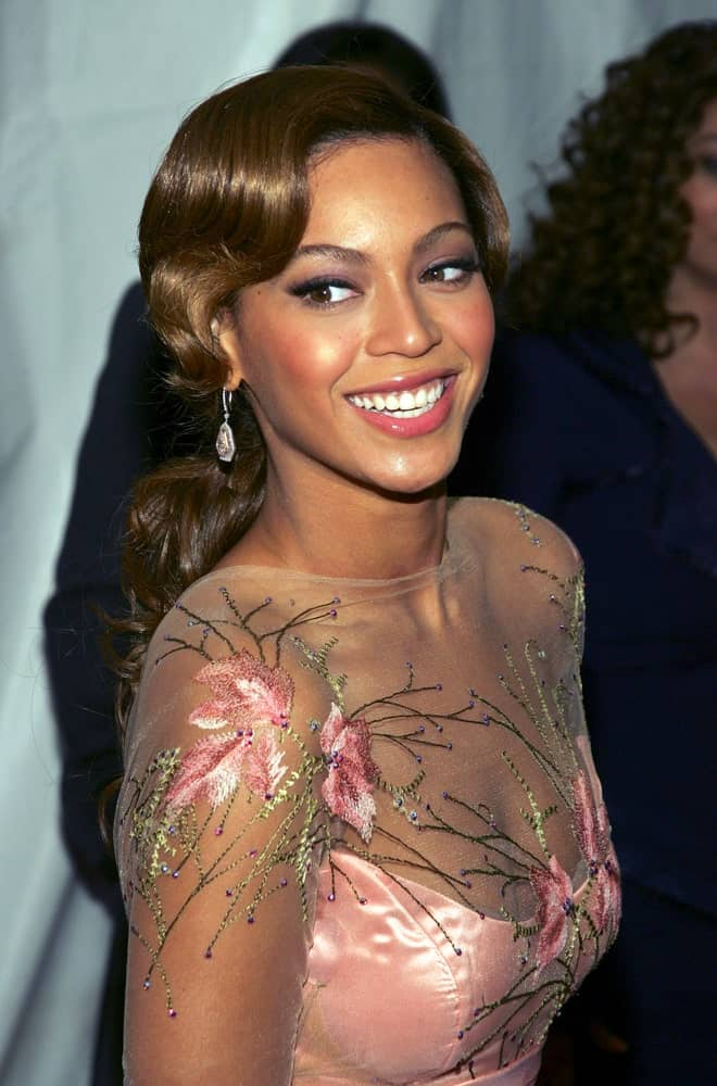 Beyonce Knowles tied her long wavy hair into a low ponytail during The Pink Panther Premiere at The Ziegfeld Theatre, New York, NY on February 6, 2006.