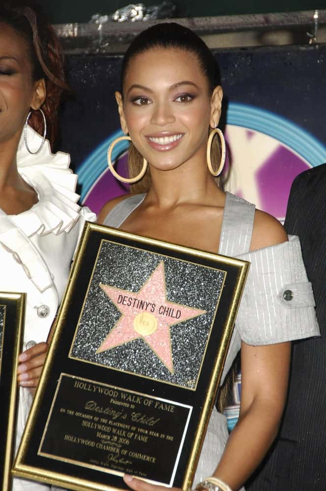 Beyonce Knowles appeared at the induction ceremony for Star on the Hollywood Walk of Fame for Destiny's Child last March 28, 2006. She had her hair in a high ponytail that she paired with hoop earrings.