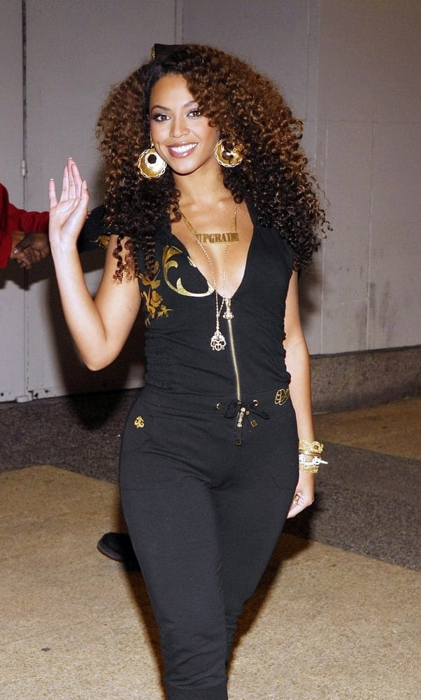Beyonce opted for a coily hairstyle at a talk show appearance for Beyonce Visits MTV's Total Request Live on February 28, 2007. She finished the look with gold accessories and a black jumpsuit.