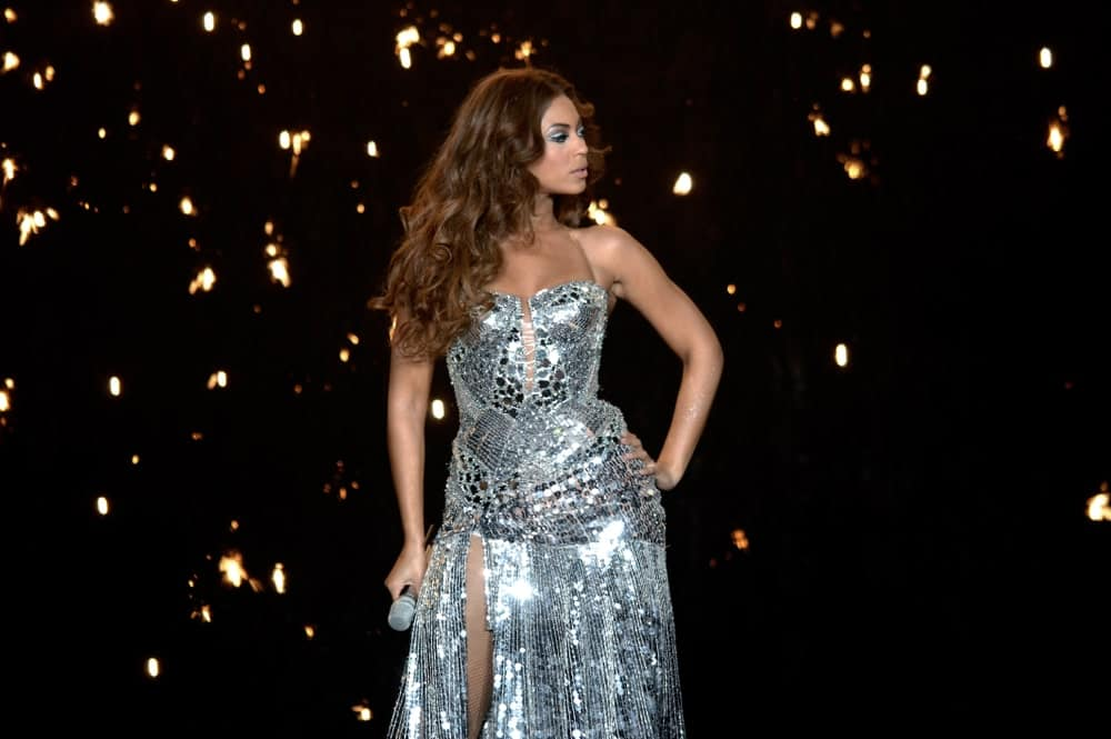 Beyonce during her live concert at the DatchForum of Assago on May 10, 2007, in Milan, Italy. She was wearing a stunning silver dress paired with her brunette curly hair.