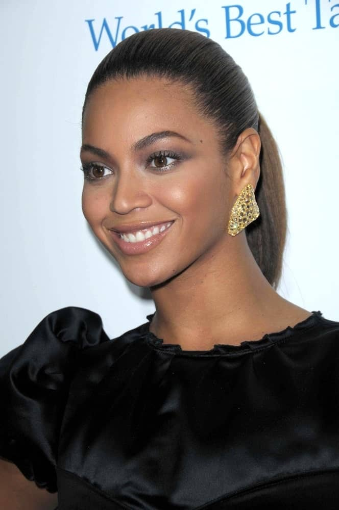 Beyonce Knowles with her brunette hair slicked back into a high ponytail during the Los Angeles Premiere of 'Cadillac Records' on November 24, 2008.
