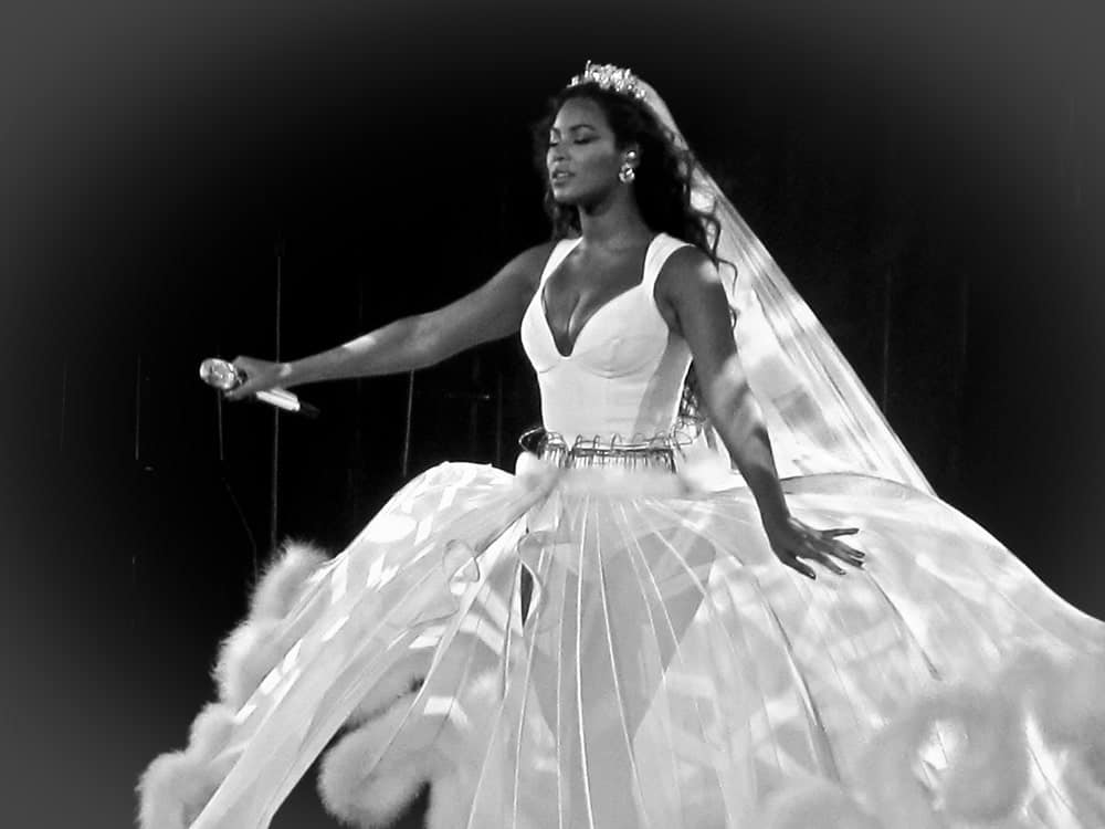 Beyonce Knowles during her show at Rod Laver Arena in Melbourne Australia on September 15, 2009, rocking a bridal gown that she contrasts with her dark long waves.