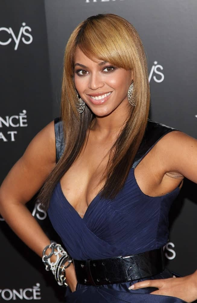 Beyonce Knowles flaunted her straight layered hair with side-swept bangs at the launch 0f her Heat! Fragrance by Coty held on February 3, 2010, in Macy's Herald Square Department Store, New York, NY.