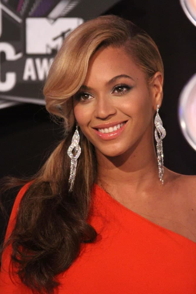 Beyonce Knowles gathered her thick wavy locks into a low ponytail with a deep side part during the 2011 MTV Video Music Awards Arrivals at Nokia Theatre LA Live, Los Angeles, CA last August 28, 2011.
