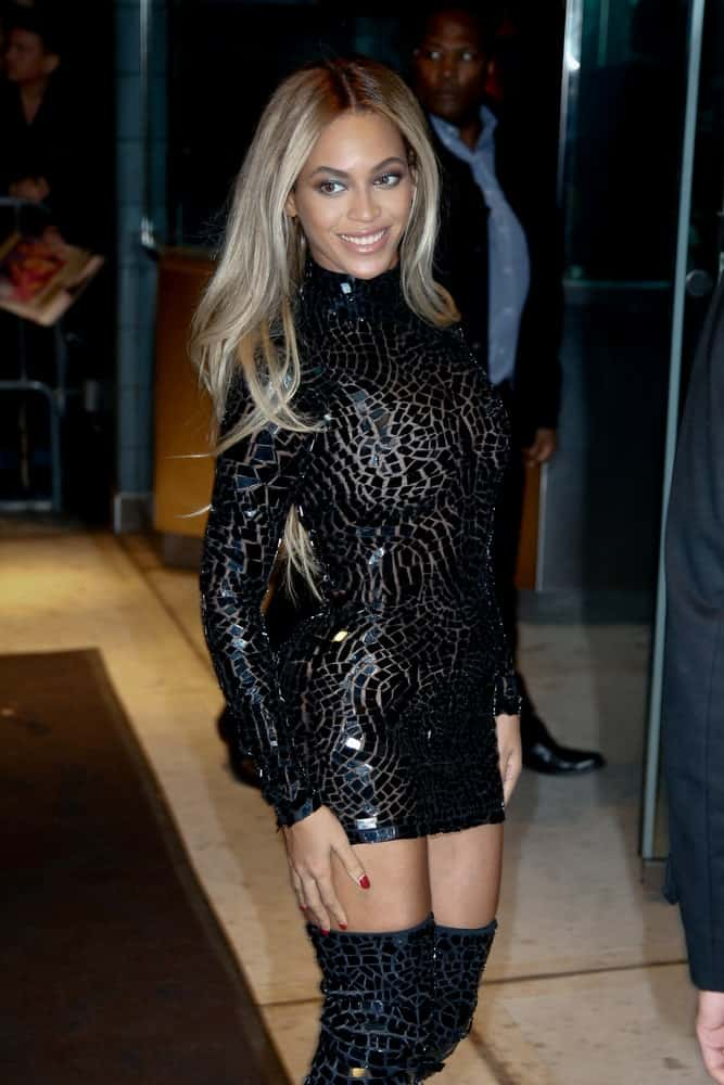 Beyonce Knowles in an edgy black outfit contrasted with her loose platinum blonde hair at release party and screening for her new self-titled album 'Beyonce' at the School of Visual Arts Theater on December 21, 2013