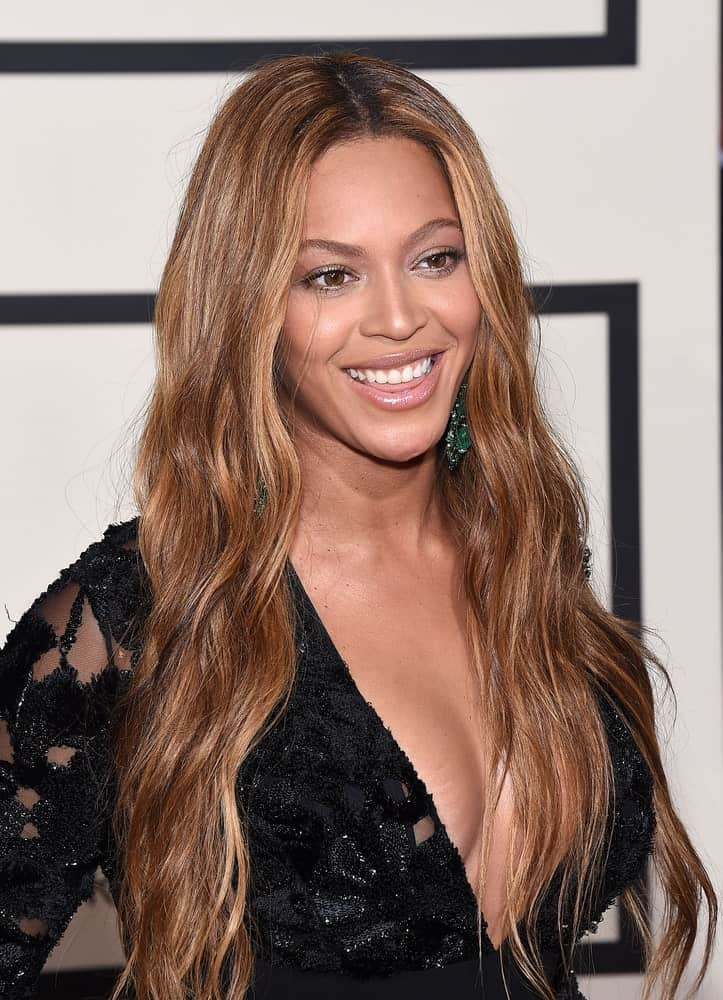 Beyonce Knowles arrived for the Grammy Awards 2015 on February 8, 2015, in Los Angeles, CA sporting a long wavy brown hairstyle that she paired with a black lace gown.