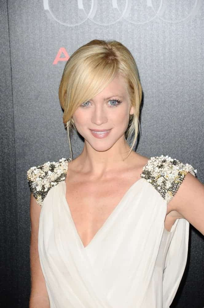Actress Brittany Snow was at the Audi and Designer J. Mendel's Kick-Off Celebration of Golden Globe Week 2011 at Cecconi's on January 9, 2011 in Los Angeles, California. She wore a white dress with her messy blonde bun hairstyle that has side-swept bangs and tendrils.