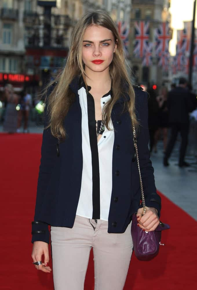 Cara Delevingne was at the 'Ill Manors' world premiere held at the Empire cinema in London, England on May 30, 2012. She wore a casual outfit with a black jacket to go with her long, tousled and layered hairstyle loose on her shoulders.