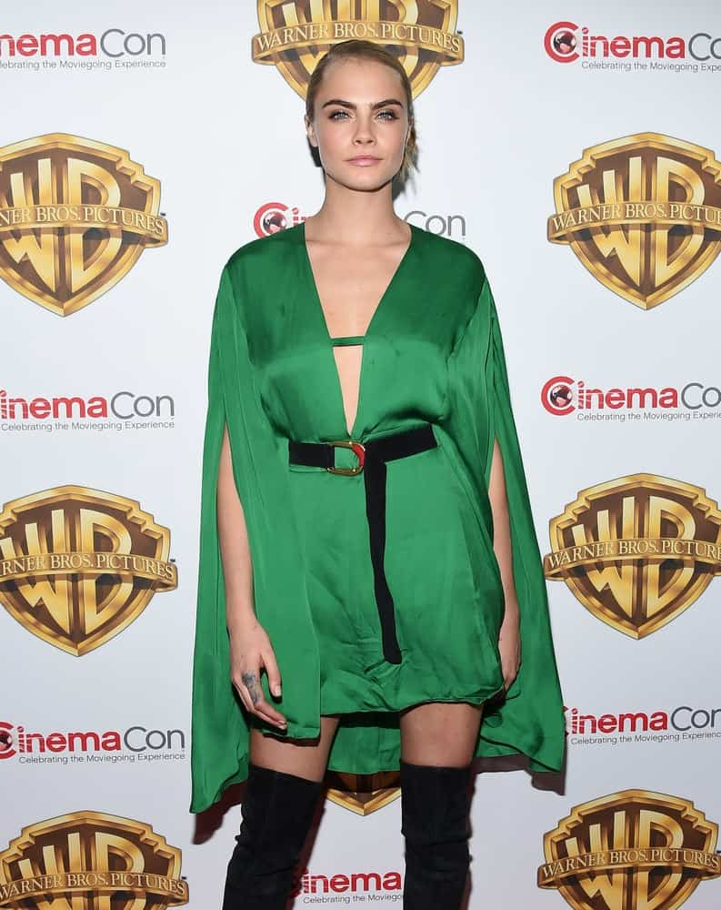 Cara Delevingne's gorgeous green silk dress went quite well with her confidence and slick bun hairstyle when she arrived at the CinemaCon 2016: Warner Bros.