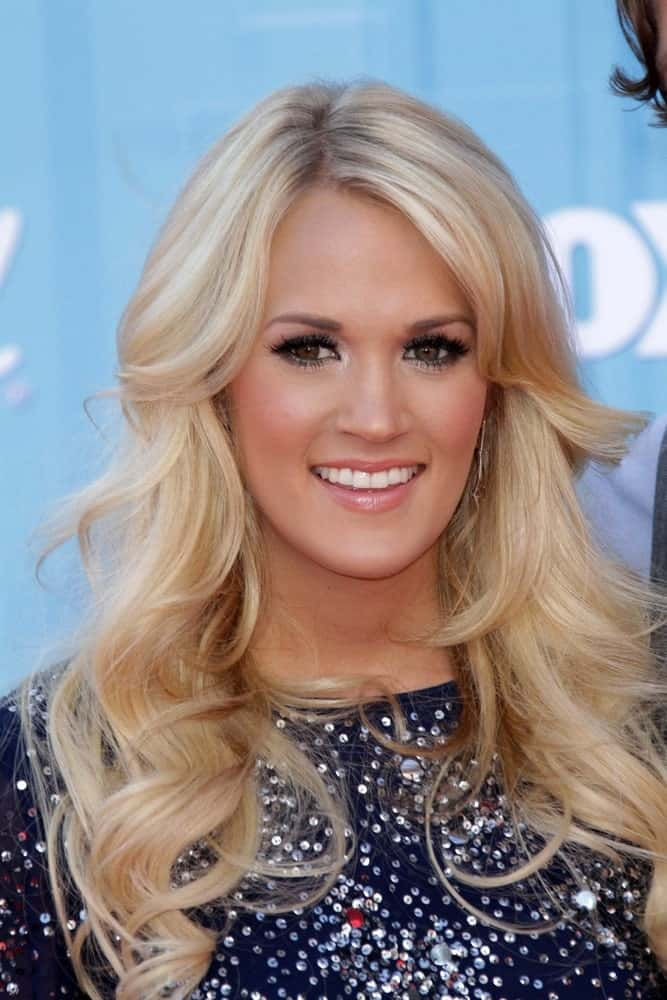 "Carrie Underwood arrived for the ""American Idol"" 2012 Finale on May 23, 2012, in a navy sequined dress and layered blonde curls."