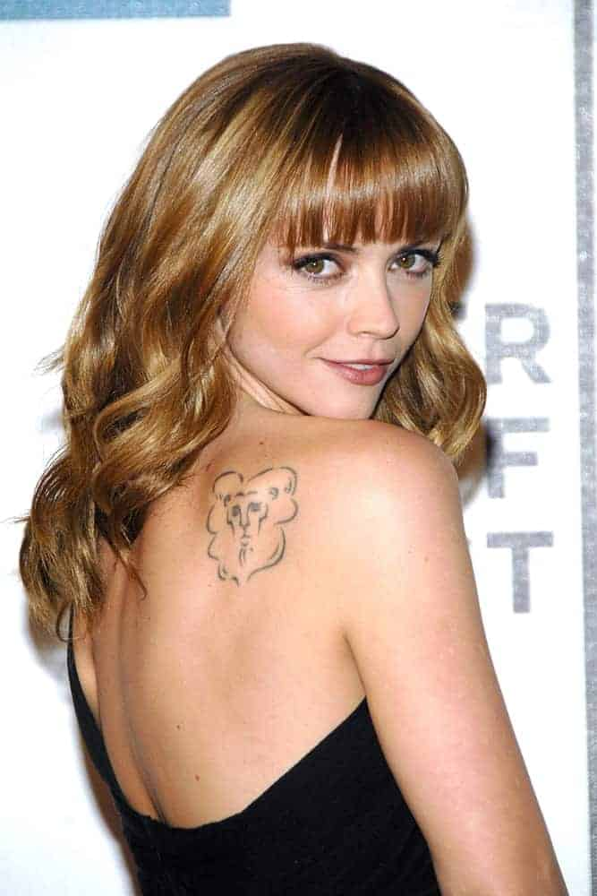 Christina Ricci attended the Speed Racer Premiere at the Closing Night of Tribeca Film Festival, Tribeca Performing Arts Center, BMCC TPAC in New York, NY on May 03, 2008. She wore a strapless black dress with her long and curly sandy blonde hairstyle with a slight tousle and blunt bangs.