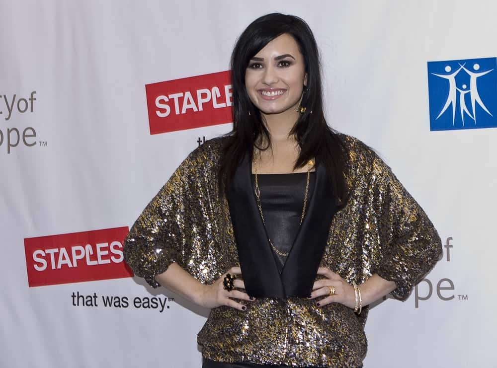 Singer Demi Lovato was at the Disney's 2nd Annual Concert For Hope at the Nokia Theatre on October 25, 2009 in Los Angeles, California. She wore a gold shimmery outfit to pair with her medium-length and straight layered raven hairstyle with side-swept bangs.