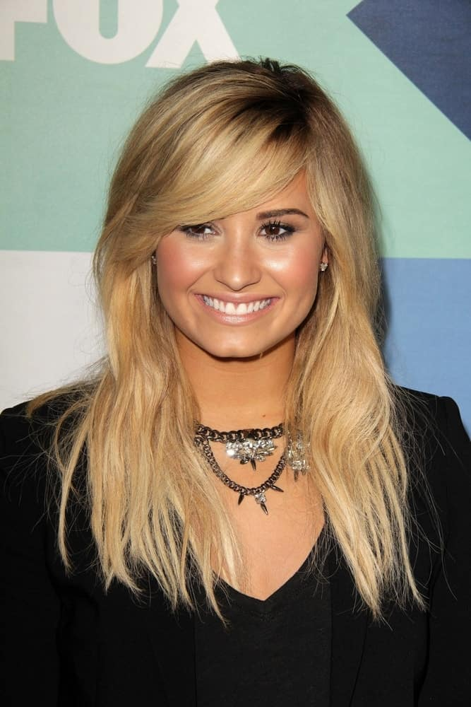 Demi Lovato flaunted her long and layered blond hairstyle with long side-swept bangs at the Fox All-Star Summer 2013 TCA Party held at the Soho House in West Hollywood, CA on August 1, 2013.